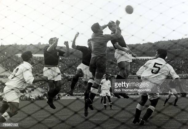 3rd May 1949 Lisbon Friendly Benfica v Torino The Benfica goalkeeper Machado punches the ball away under pressure from Torino's Menti Bongiorni and...