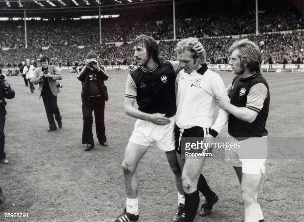 3rd May 1975 1975 FA Cup Final at Wembley West Ham United 2 v Fulham 0 West Ham United captain Billy Bonds left and Graham Paddon console Fulham...