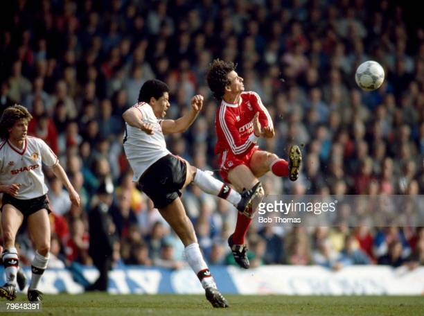 4th April 1988 Division 1 Liverpool 3 v Manchester United 3 Manchester United's Paul McGrath watched by Jesper Olsen clears from the flying Craig...