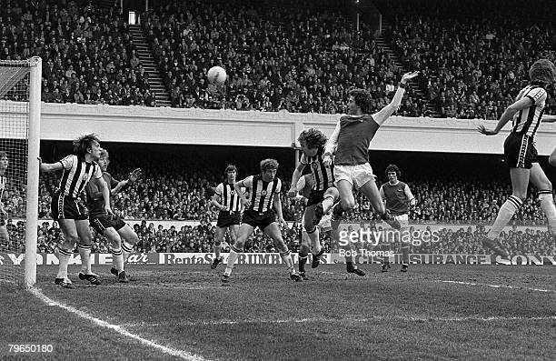4th December 1976 Division 1 Arsenal 5 v Newcastle United 3 at Highbury Arsenal's Trevor Ross right beats the Newcastle United defence to power a...