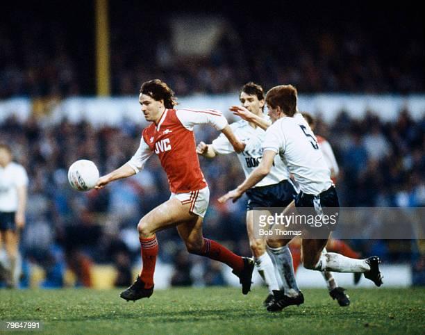 4th January 1987 Division 1 Tottenham Hotspur 1 v Arsenal 2 Arsenal striker Charlie Nicholas moves away from Tottenham Hotspur no5 Richard Gough