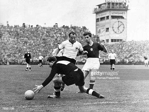 4th July 1954 World Cup Final in Berne West Germany 3 v Hungary 2 The German goalkeeper Turek attempts to gather the ball under pressure from...
