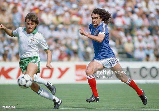 4th July 1982 1982 World Cup Finals in Spain Northern Ireland 1 v France 4 in Madrid France's Dominique Rocheteau races for the ball with Northern...