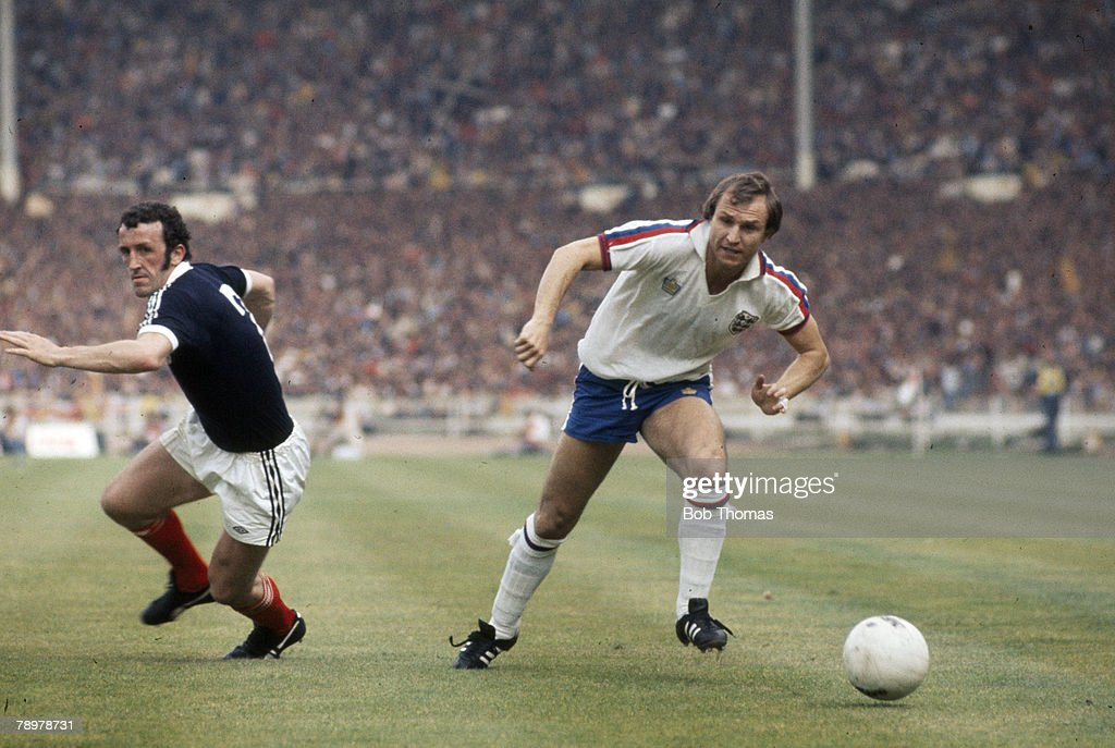 4th June 1977, British Championship at Wembley, England 1 v Scotland 2, England's Dennis Tueart, right, moves past Scotland defender Danny McGrain