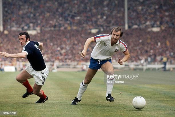 4th June 1977 British Championship at Wembley England 1 v Scotland 2 England's Dennis Tueart right moves past Scotland defender Danny McGrain