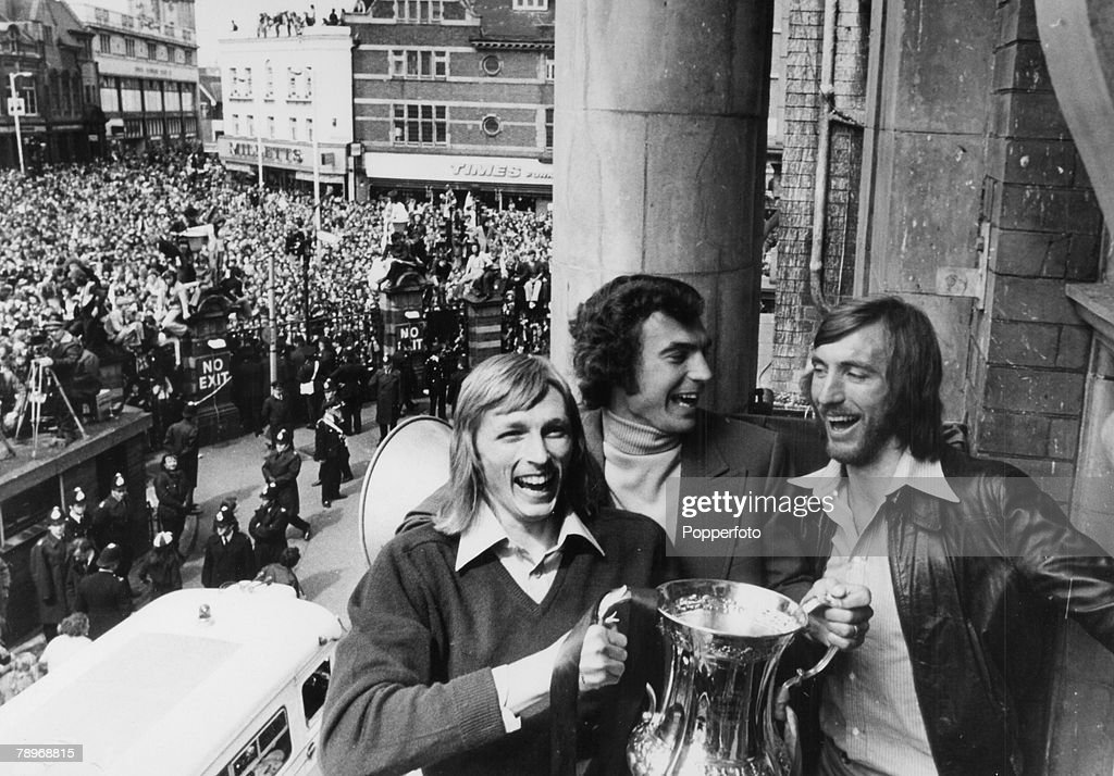 Sport. Football. pic: 4th May 1975. 1975 FA. Cup Final at Wembley. West Ham United 2 v Fulham 0. Celebrations at Newham Town Hall. West Ham United striker Alan Taylor, the 2 goal match-winning hero, holds the trophy alongside Trevor Brooking and captain B : News Photo