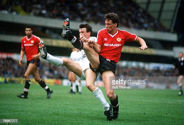 4th May 1987 Division 1 Tottenham Hotspur 4 v Manchester United 0 Manchester United's Mike Duxbury right in a high kicking challenge with Tottenham...