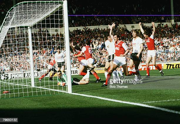 5th April 1987 Littlewoods Cup Final at Wembley Arsenal 2v Liverpool 1 Arsenal's Charlie Nicholas grabbed by number 6 Tony Adams as they celebrate...