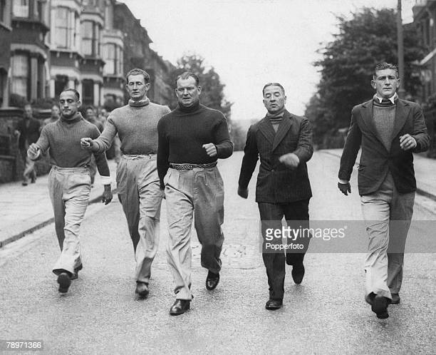 5th August 1936 Arsenal footballers back in training for the imminent start to the new season are taken for long walks around the streets of London's...