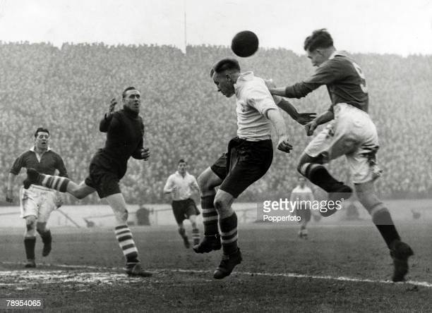 5th February 1949 Division 1 Chelsea v Preston North End Chelsea centre forward Roy Bentley right leaps to score Chelsea's 1st goal with a header