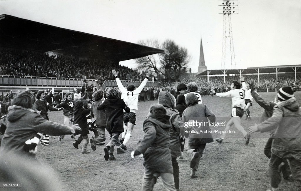 5th February 1972, FA, Cup 3rd Round Replay at Edgar Street, Hereford, Hereford United 2 v Newcastle United 1, a,e,t, Hereford fans and players rush to the No 11 Ronnie Radford who had scored a late equaliser to level the scores, Hereford achieved a shock win in extra time with a winning goal from Ricky George