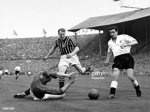 5th May 1956 FA Cup Final at Wembley Manchester City 3 v Birmingham City 1 Manchester City goalkeeper Bert Trautmann watched by teammate Dave Ewing...