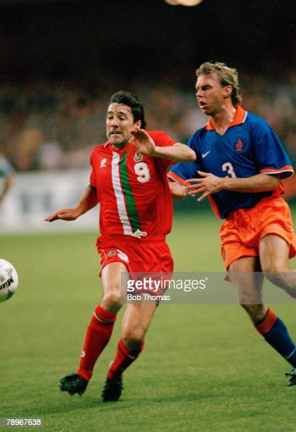 5th October 1996 World Cup Qualifier in Cardiff Wales 1 v Holland 3 Wales striker Dean Saunders challenged by Holland's S Valckx Dean Saunders won 75...