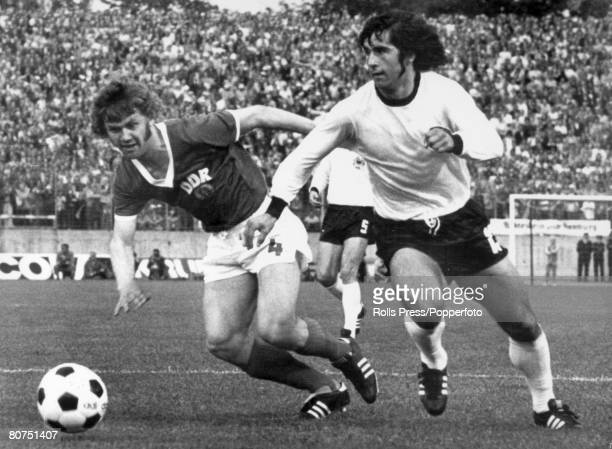 6th July 1974, 1974 World Cup Finals in Germany, Hamburg, Group Match, East Germany 1 v West Germany 0, West Germany's Gerd Muller right, moves away...