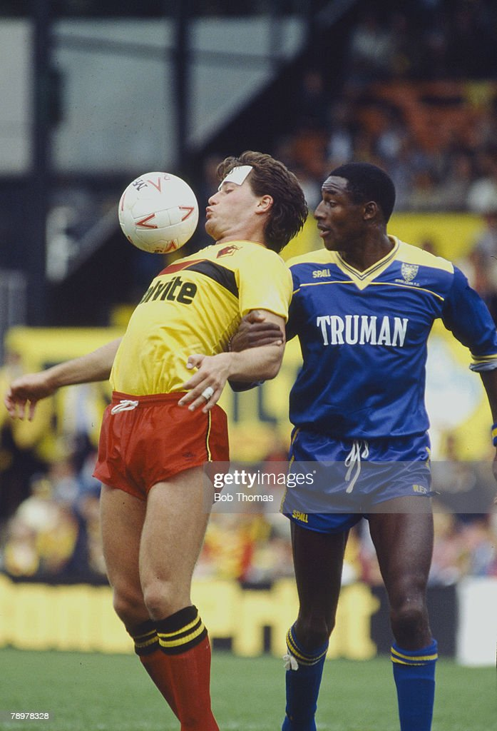 Sport. Football. pic: 6th September 1986. Division 1. Watford 0 v Wimbledon 1. Watford's Steve Terry looks to control the ball watched by Wimbledon's John Fashanu. : News Photo