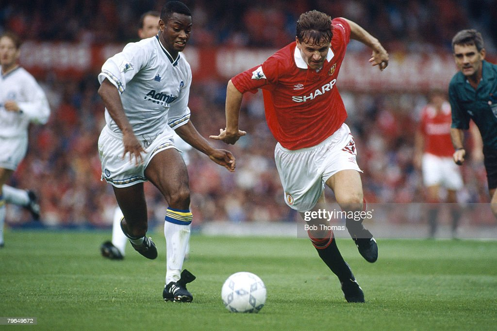 BT Sport, Football, pic: 6th September 1992, Premier League, Manchester United 2 v Leeds United 0, Manchester United's Andrei Kanchelskis is chased by Leeds United's Chris Fairclough : News Photo
