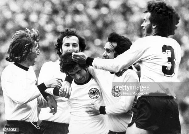 7th July 1974 1974 World Cup Final in Munich West Germany 2 v Holland 1 West Germany's Gerd Muller is mobbed by teammates leftright Jurgen Grabowski...