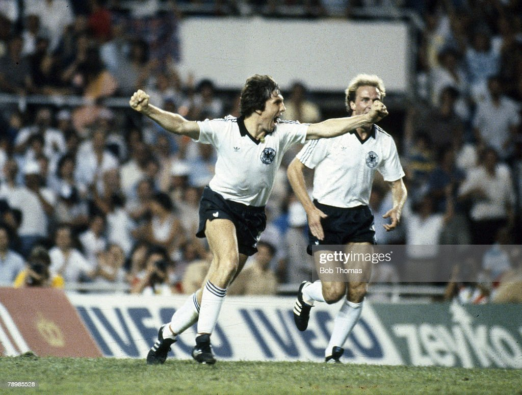 BT Sport. Football. pic: 8th July 1982. World Cup Semi-Final in Seville. West Germany 3 v France 3. West Germany win on penalties. West Germany's Klaus Fischer races away to celebrate having scored their 3rd goal. : News Photo