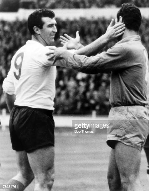 8th May 1963 Friendly International at Wembley England 1 v Brazil 1 England's burly centre forward Bobby Smith left in a lighthearted encounter with...