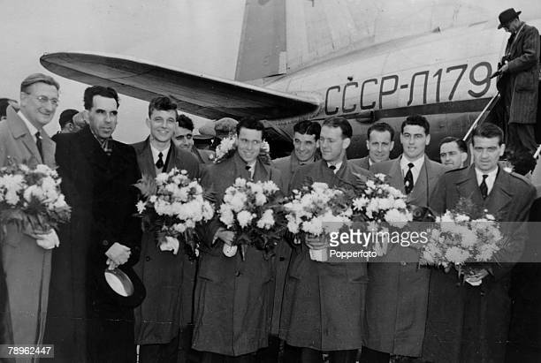 8th October 1954 Moscow Arsenal FC presented with bouquets after their arrival at Vnukpvo Airport Leftright Bob Wall Russian Official David Herd...