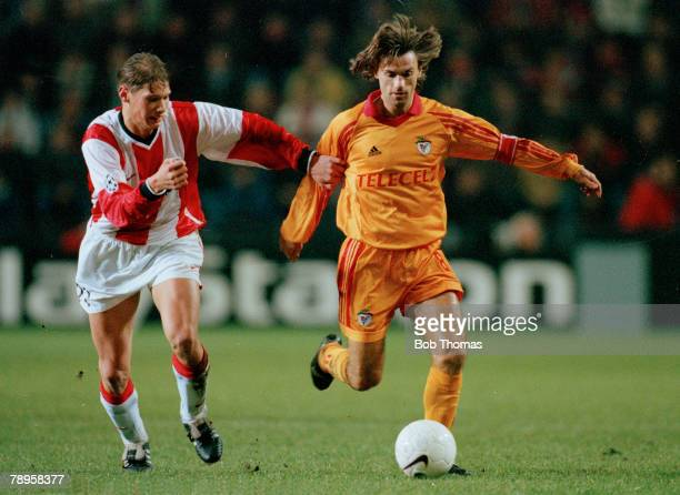 9th December 1998, UEFA, Champions League, PSV,Eindhoven 2 v Benfica 2, Benfica's Joao Pinto is held back by PSV, Eindhoven's Theo Lucius