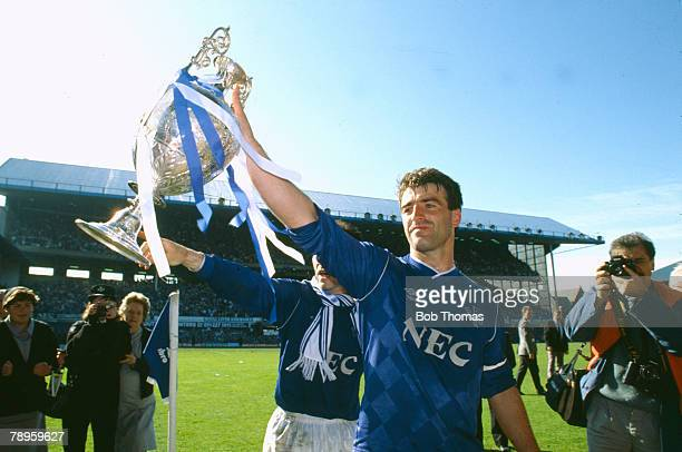 9th May 1987 Division 1 Everton 3 v Luton Town 1 Kevin Ratcliffe Everton central defender and captain parades the Division 1 Championship trophy