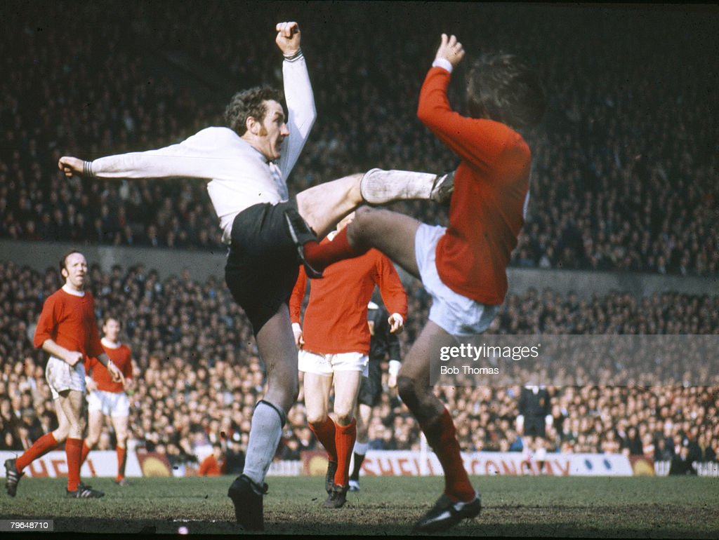 April 1971, Division 1, Derby County defender Dave Mackay and Manchester United's George Best both going into the tackle with their boots high
