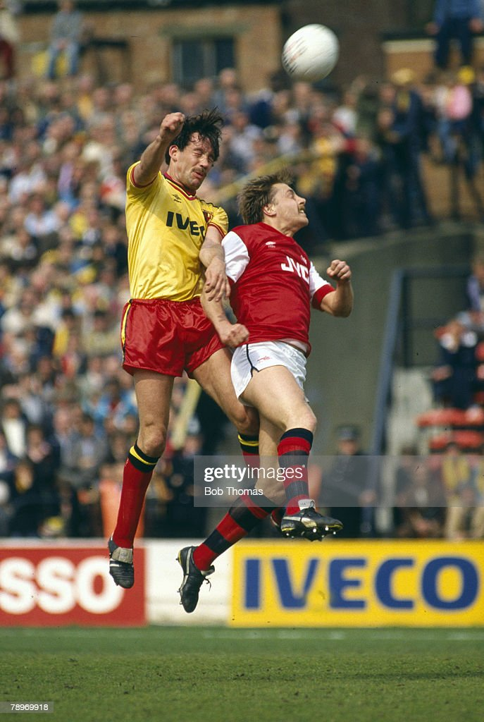 BT Sport. Football. pic: April 1985. Division 1. Watford 2 v Arsenal 1. Watford's Steve Sims outjumps Arsenal's John Hawley. : News Photo
