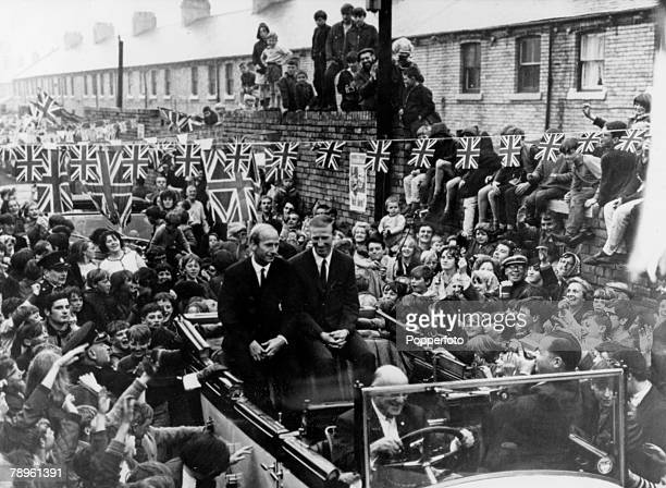 August 1966 Ashington Northumberland England stars the brothers Bobby left and Jack Charlton in an open top Rolls Royce as they get a heroes welcome...