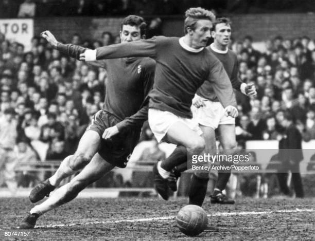 August 1966 Manchester United's Denis Law moves past Chelsea's Peter Osgood