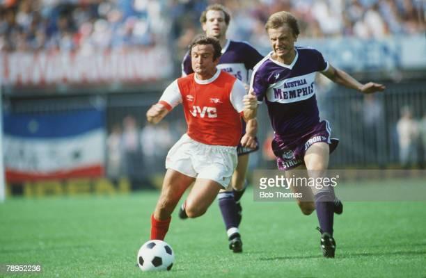 August 1982, Rotterdam Tournament, Arsenal v Austria Vienna, Arsenal's John Hollins, left, races with Vienna's Erich Obermayer