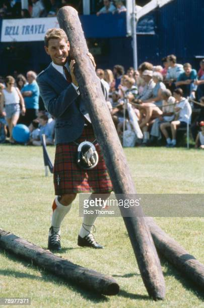 August 1988 Feature Glasgow Rangers' Englishman Terry Butcher at a Highland Games gathering tries tossing the caber
