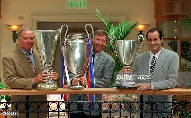 August 1993 Managers leftright Ron Atkinson Aston Villa Alex Ferguson Manchester United and Arsenal Manager George Graham with the trophies they are...