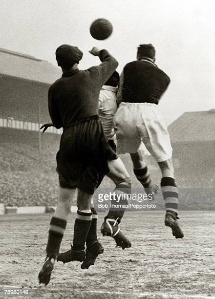 circa 1935 Tottenham Hotspur v West Ham United Spurs goalkeeper Allan Taylor punches the ball away during a West Ham United attack at White Hart Lane