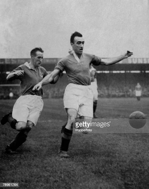 circa 1948 John Aston the Manchester United full back moves away from Portsmouth's Peter Harris
