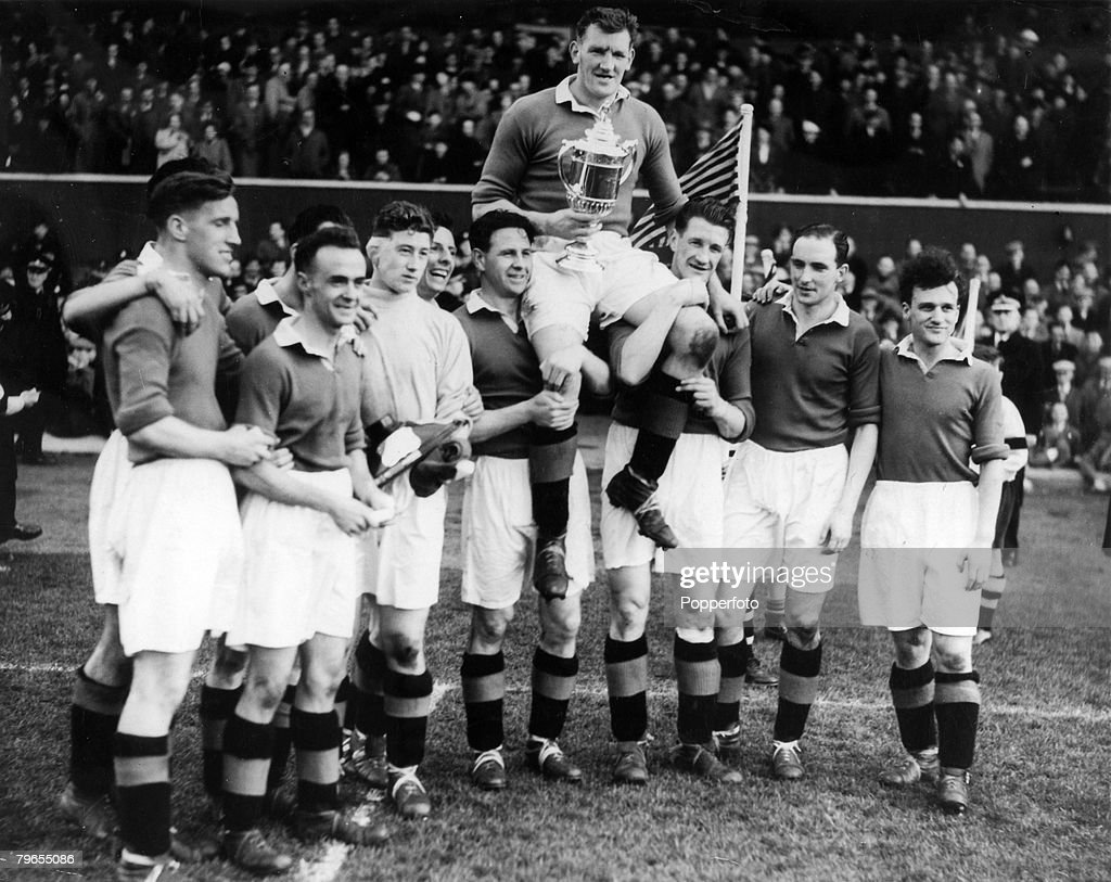 Sport, Football, pic: circa 1948, Rangers' captain George Young held aloft by his team-mates as the team celebrate a Scottish FA Cup Final victory, George Young , one of the great Scottish defenders won 53 Scotland international caps between 1947-1957 : News Photo