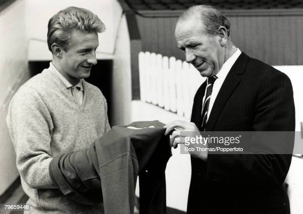 Circa 1963, Manchester United Manager Matt Busby and his Manchester United striker Denis Law