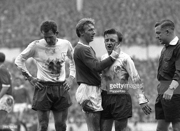 circa 1964 Division 1 Tottenham Hotpur v Manchester United at White Hart Lane Manchester United's Denis Law grabs Tottenham Hotspur's Terry Dyson by...