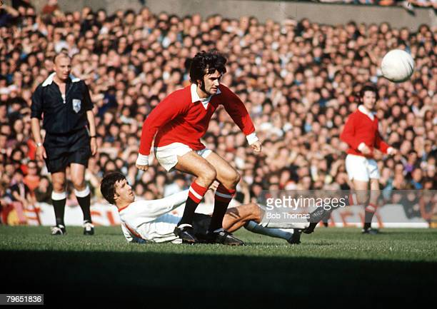 circa 1968 Manchester United's George Best beats an opposing defender