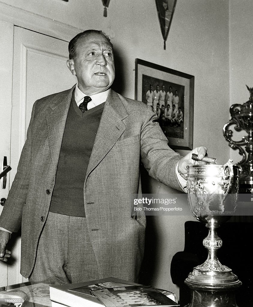 Sport. Football. pic: circa 1970. Real Madrid President Santiago Bernabeu. He was the Club President from 1943-1978. The famous Madrid Stadium was renamed in in his honour. In this photograph he appears to be using a trophy as an ashtray for his cigar. : News Photo