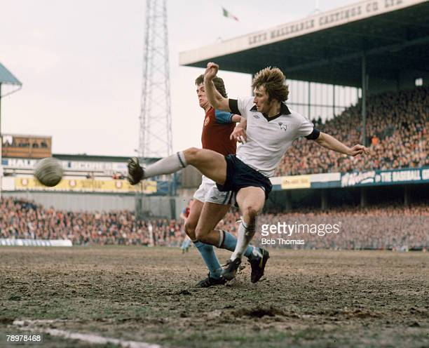 circa 1978 Derby County defender Colin Todd clears from Aston Villa's John Deehan