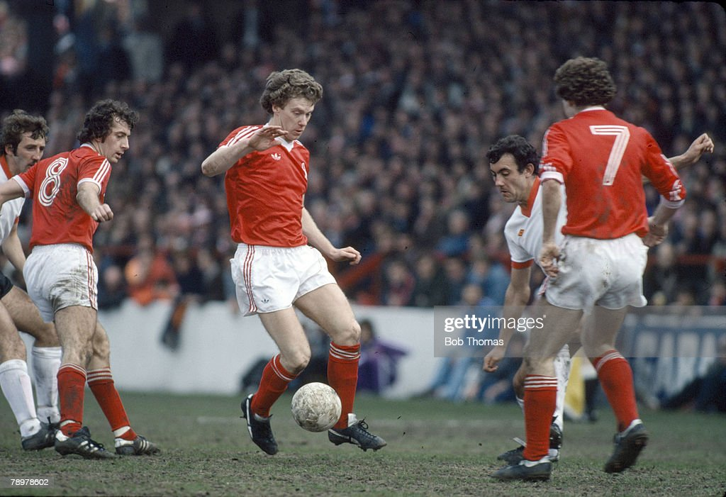 Sport. Football. pic: circa 1979. Division 1. Nottingham Forest v Liverpool. Nottingham Forest striker Tony Woodcock on the ball surrounded by players. Tony Woodcock won 42 England international caps between 1978-1986. : News Photo