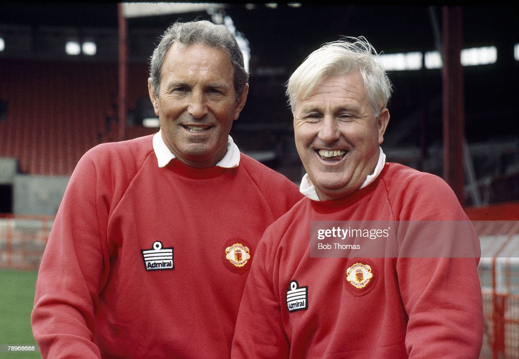 circa 1980, Dave Sexton, Manchester United Manager 1977-1981, left, with his assistant Tommy Cavanagh