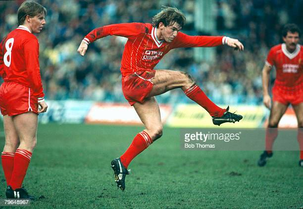 circa 1980 'Grace in Sport' Liverpool's Kenny Dalglish in action watched by Sammy Lee