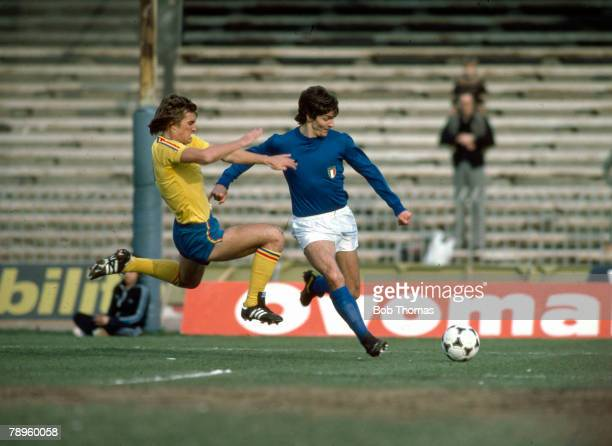 circa 1980 International Match in Naples Italy's Paolo Rossi on the ball as Romania's Tiliho challenges Paolo Rossi Italy striker was a World Cup...