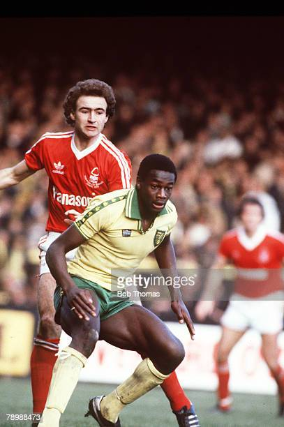 circa 1980 Justin Fashanu Norwich City challenged by Nottingham Forest's Martin O'Neill