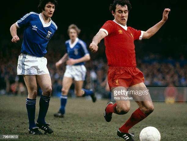 circa 1980 Liverpool's Ray Kennedy on the ball watched by Ipswich Town's George Burley