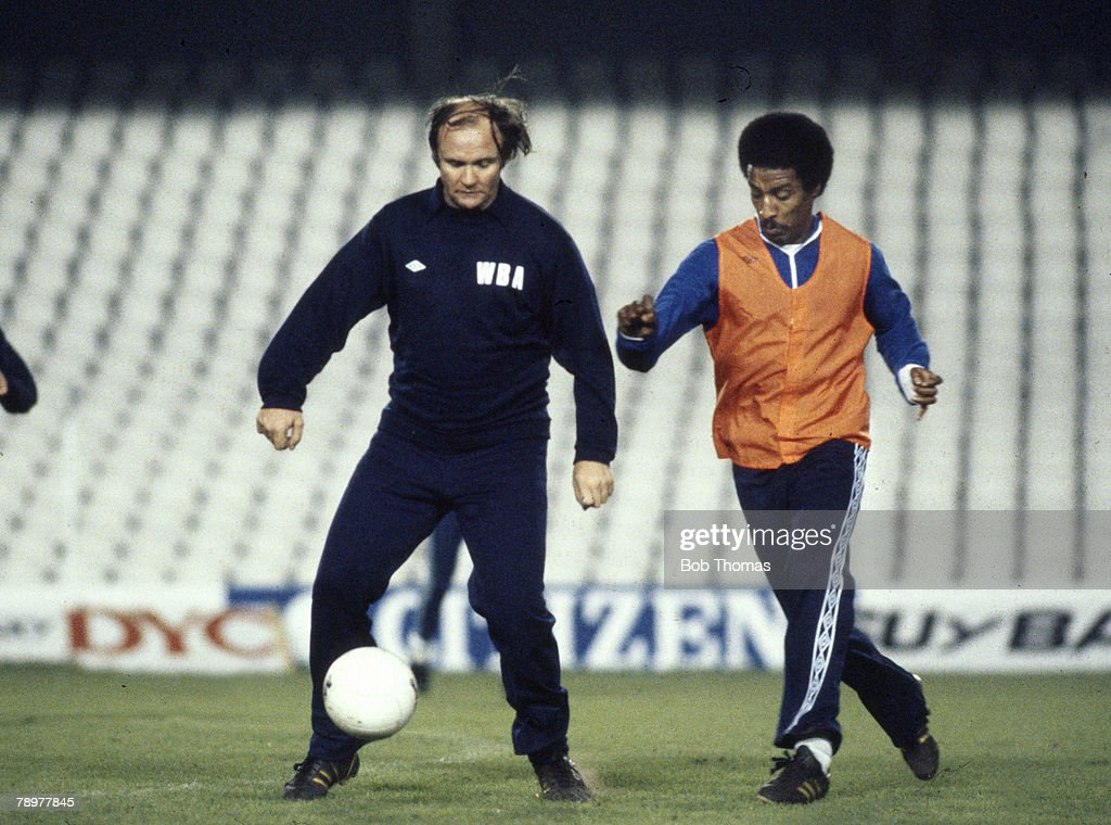 Sport. Football. pic: circa 1980. West Bromwich Albion Training in Madrid. West Bromwich Albion Manager Ron Atkinson is challenged by defender Brendan Batson. : News Photo