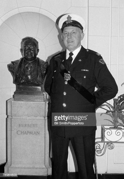 circa 1980's Arsenal Commissionaire Nobby Clarke in front of the bust of Herbert Chapman