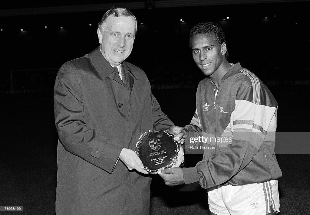 Sport. Football. pic: circa 1986-1987. Arsenal's David Rocastle, (right), receives the Barclay's League Young Eagle award. : News Photo